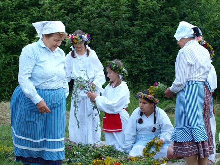 rites: Women weaving wreaths as part of rites of the Night of St. John, Open Air Museum of the Lublin Region Village, Lublin, Poland, June 24th 2011 Editorial