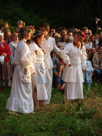 Young people singing and dancing around a bonfire as part of the rites of St. John Stock Photo - 9890576