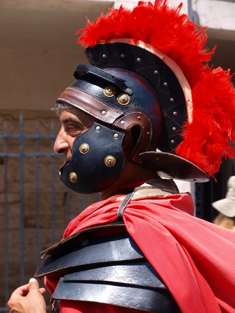 Profile of a fully-equipped street centurion in Rome, Italy, 4th June 2011