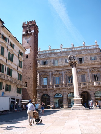 Piazza delle Erbe. The column with the Lion of Saint Mark and the Maffei Palace with Gardello tower, Verona, Italy