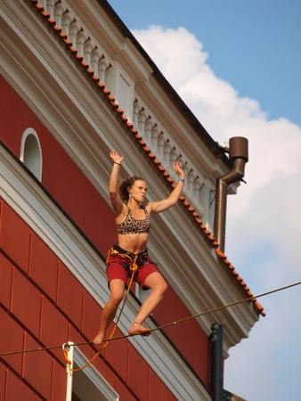 A slackliner walks on webbing stretched above the streets of the old town of Lublin during the second edition of the summer Festival of Circus Art (Carnaval Sztuk-Mistrzow) 28th-31st July 2011 in Lublin, Poland, July 28th 2011