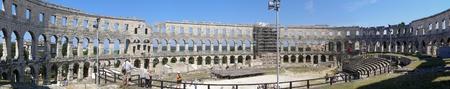Tourists inside Arena in Pula, Croatia