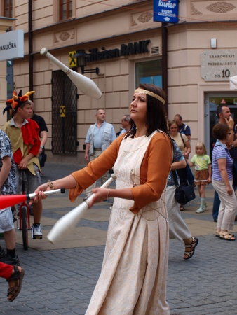 Female juggler during the march-past of the royal suite and jugglers during the annual Jagiellonian Fair (12th-14st August 2011), Lublin, Poland, August 13th 2011.