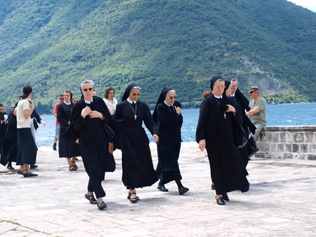 nun: Pilgrims at the sanctuary of Our Lady on the Rock, Perast, Montenegro, June 5th 2010 Editorial