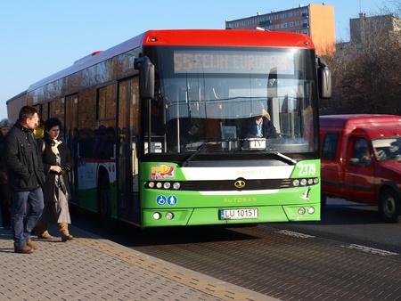 A bus Autosan M12LE Sancity of Municipal Public Transport, Lublin, Poland at the bus stop.