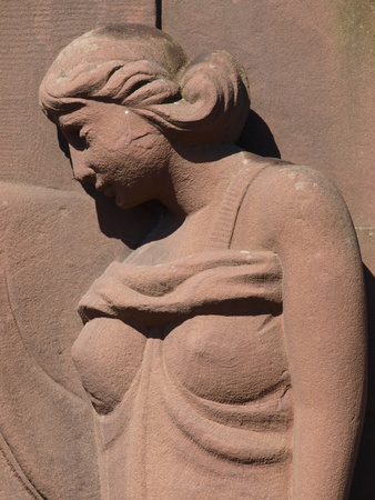 A bas-relief of a woman on a grave photo