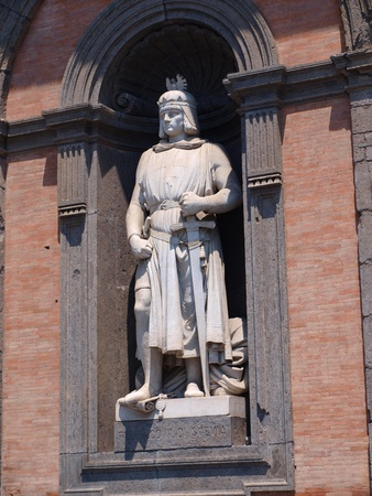 reale: Statue of a king Federick II in the wall of the Royal Palace in Naples, Italy