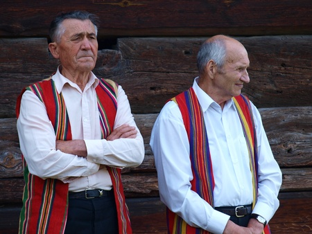 rites: Two senior gentlemen from the rites team Hansk talking about the customs of the Night of St. John, an old Polish (and Slavic) folk event, June 24th 2011, Open-Air Museum of the Lublin Region Village, Lublin, Poland Editorial