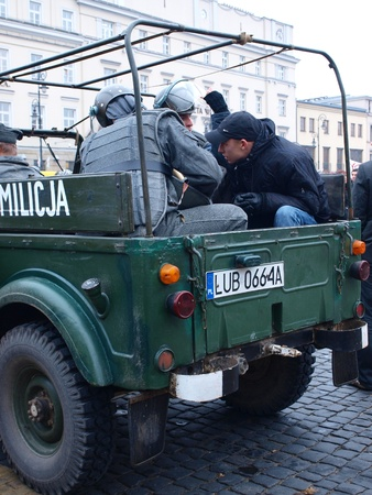 opponents: Celebrations of the 30th Anniversary of introducing the Martial Law In Poland on December 13th 1981: staging of the demonstrations against the introduction of the Martial Law, arrested opponents in ZOMO car, Lublin, Poland, Dec, 13th 2011. Editorial