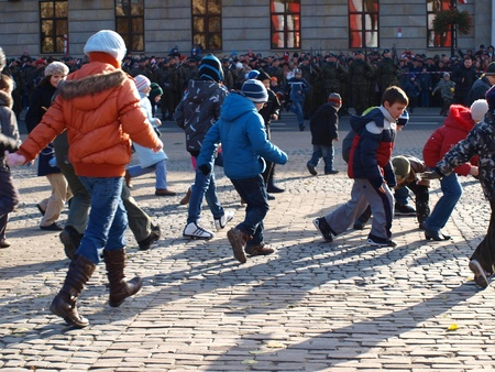 lubelszczyzna: Celebrations of the Independence Day, Lublin, Poland, 11th November, 2011. Children collecting bullet cases after an honorary salvo.