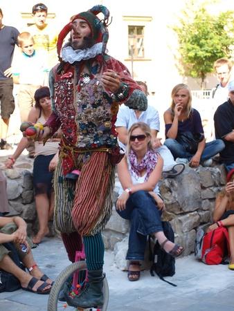 The street performance of a juggler during the summer Festival of Circus Art (Carnaval Sztuk-Mistrzow), Lublin, Poland, August 21st 2010.
