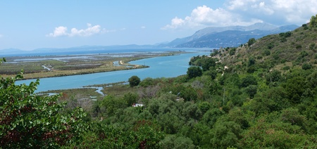 The panoramic view of Vivari Channel which links Lake Butrint in Albania with the Straits of Corfu, and forms a border of the peninsula of Butrint. Stock Photo