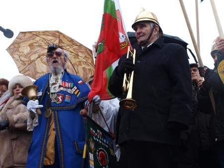 Lublin, Poland, January 6th 2012: the parade of the Three Kings. A town crier/bellman (on the left) and bugle-caller. Stock Photo - 11925332