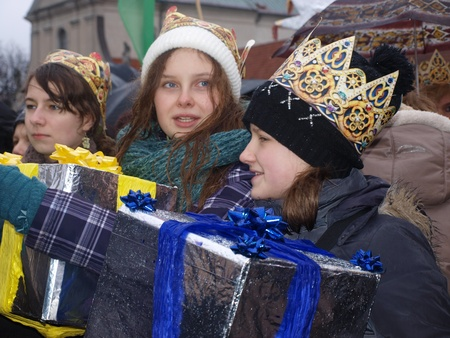 street wise: Lublin, Poland, January 6th 2012: the suite of the Three Kings. Teens carrying gifts for Infant Jesus