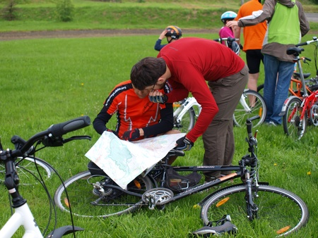 Men consulting the map before the trip. Planet Lublin, a biking event in Lublin, Poland, May 30th 2010