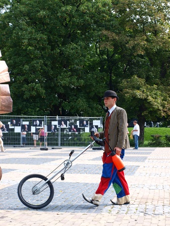 Clown with a unicycle during the annual Jagiellonian Fair (12th-14st August 2011), Lublin, Poland, August 13th 2011.