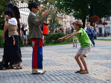 busker: Clown with a boy during the annual Jagiellonian Fair (12th-14st August 2011), Lublin, Poland, August 13th 2011.