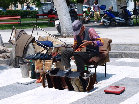 A man cleaning shoes in a street, Prilep, Macedonia
