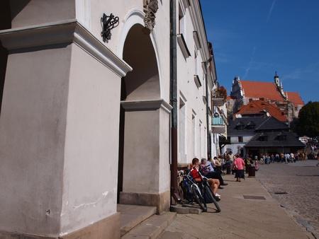 Cyclists taking a rest at the market square of Kazimierz Dolny, Kazimierz Dolny, Poland