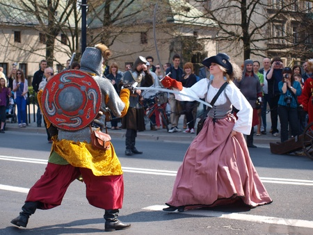 Father teaching his daughter fancing at the historical reenactment from the 18th century, Lublin, Poland, April 21st 2012.