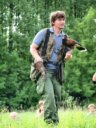 Falconer with the bird at the historical reenactment show, Zawieprzyce, Poland, May 6th 2012.
