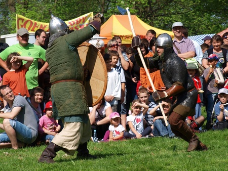 Knights fighting with a sword and an axe in the historical reenactment event, Zawieprzyce, Poland, May 6th 2012
