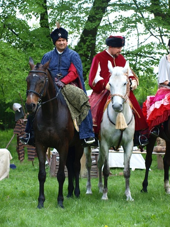 reconstructing: The commander of Polish army King John III Sobieski (on the right) and voivode Atanazy Miaczynski (on the left) return home after victorious Battle of Vienna in 1683: the historical reenactment show, Zawieprzyce, Poland, May 6th 2012. Editorial