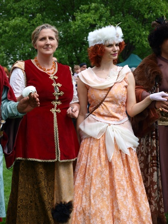 reconstructing: Ladies in typical 17th century outfits at the historical reenactment event, Zawieprzyce, Poland, May 6th 2012.