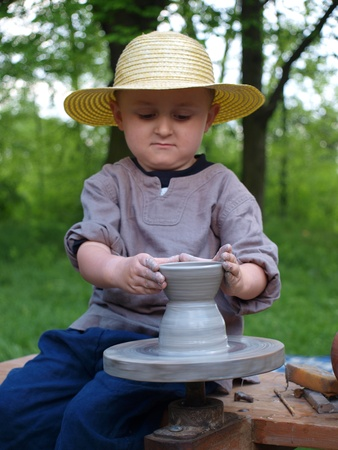 reconstruct: A Slavic potter at the historical reenactment event, Zawieprzyce, Poland, May 6th 2012.