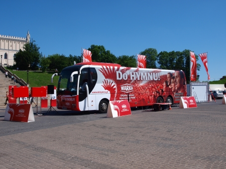 lubelskie: A moving recording studio on a bus of Warka, beer-maker, on a tour around Poland, where people could sing and record the national anthem to supper the Polish national football Euro 2012 team, Lublin, Poland May 22th 2012. Editorial