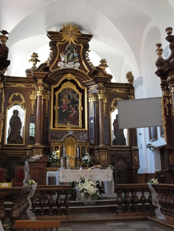 The inside of the Church of the Annunciation of the Virgin Mary, Kazimierz Dolny, Poland, with the miraculous painting in the altar.  Stock Photo - 14443964