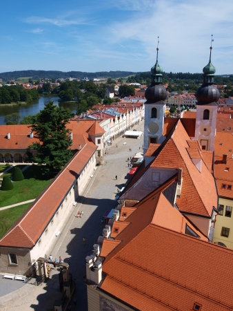 View of Telc with the towers of the Church of the Name of Jesus and Zacharias of Hradec Square from the belltower of Saint James church, Telc, Czech Republic photo