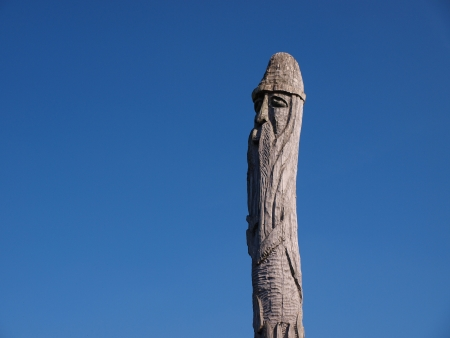 One of the wooden totem poles representing an idol surrounding an old early-medieval burg and settlement in Zmijowiska, Poland