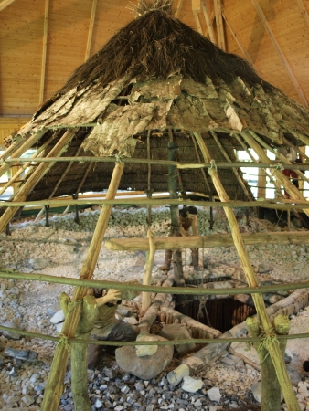 neolithic: Reconstruction of a shaft and workshop in the neolithic mine of striped flint, Archeological-Natural Reserve Krzemionki, Krzemionki, Poland Editorial