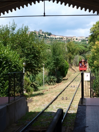 Lower station of a red funicular at Montecatini Terme taking passengers to Montecatini Alto, Italy