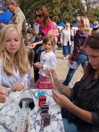 Children performing experiments at the 10th edition of Festival of Science, 15th September 2013, Lublin, Poland