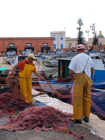 Fishermen at work, Favignana, Sicily, Italy