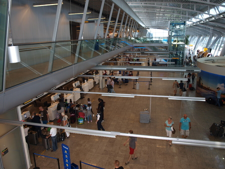 hall monitors: Check-in counters at the airport of Eindhoven, Netherlands Editorial