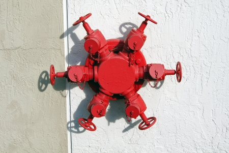 red hydrant on the wall