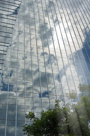 skyscraper pane with reverberating sky and reflected rays