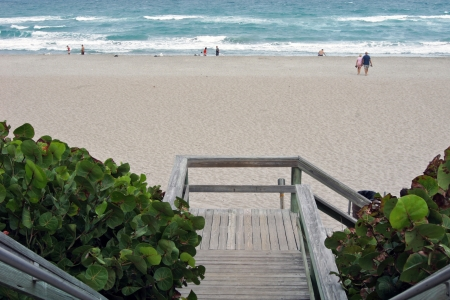 wooden stair to the oceans sandy beach photo