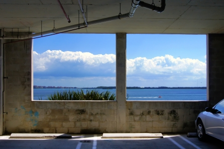 two windows in public garage with ocean view in suny day                    Stock Photo