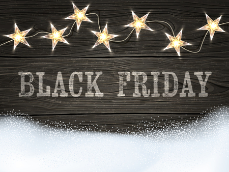 white wood: Black Friday sign on wooden background with star-shaped lights and snow.