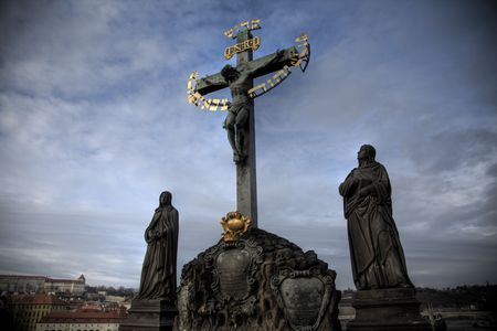 hebrew letters: A statue of a cross with hebrew letters, on Charles Bridge, Prague, The Czech Republic Stock Photo