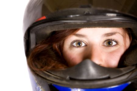 a girl wearing a helmet and looking at the camera