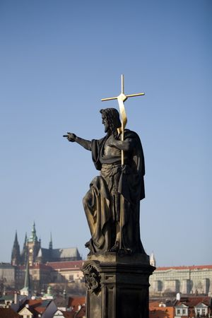 A statue on the Charles Bridge, Prague, The Czech Republic photo