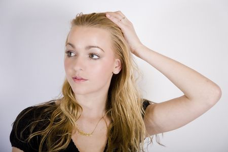 a pretty blond girl looking at the camera Stock Photo