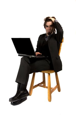 a businessman sitting and working with his computer