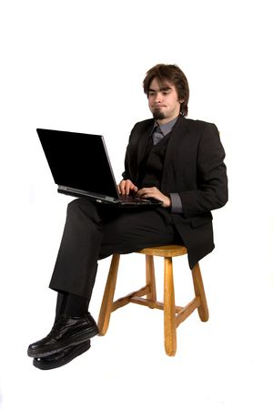 businessman working at his computer: a businessman sitting and working with his computer