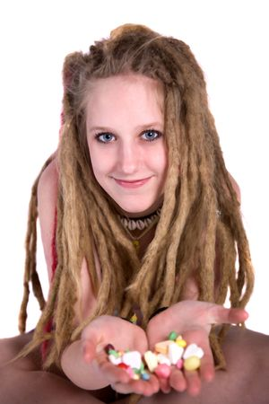 dutch girl: Pretty Blond girl with dreads looking at the camera and holding candies